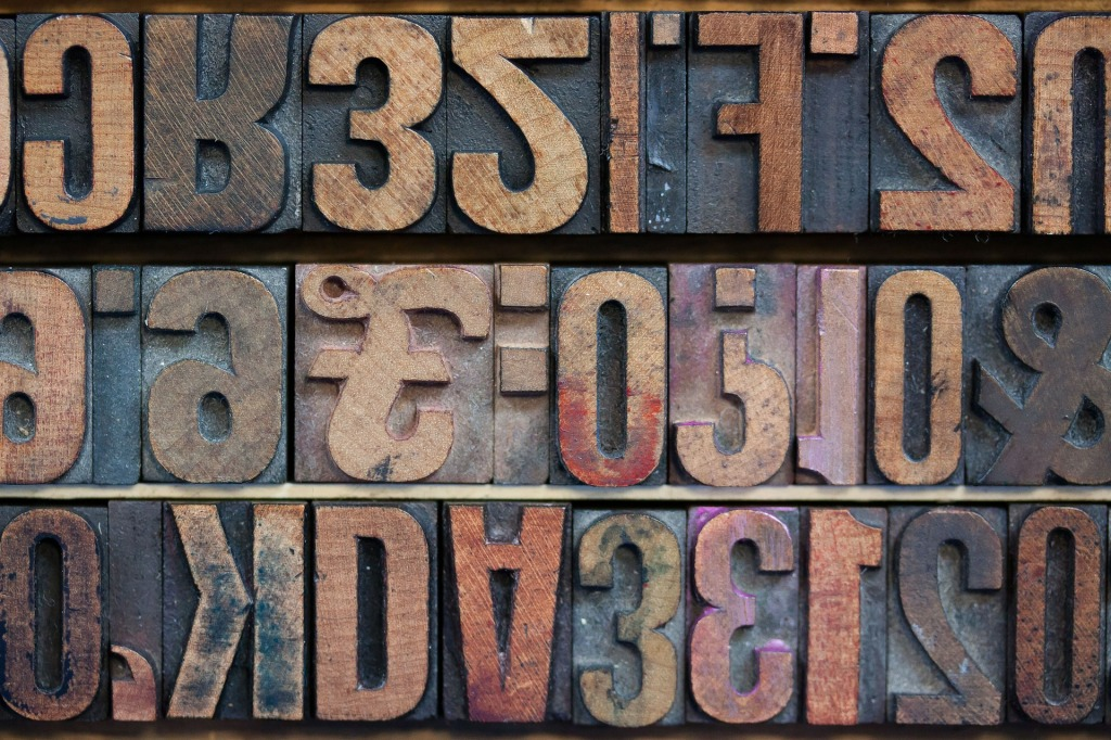 Typeface letters cut from wood